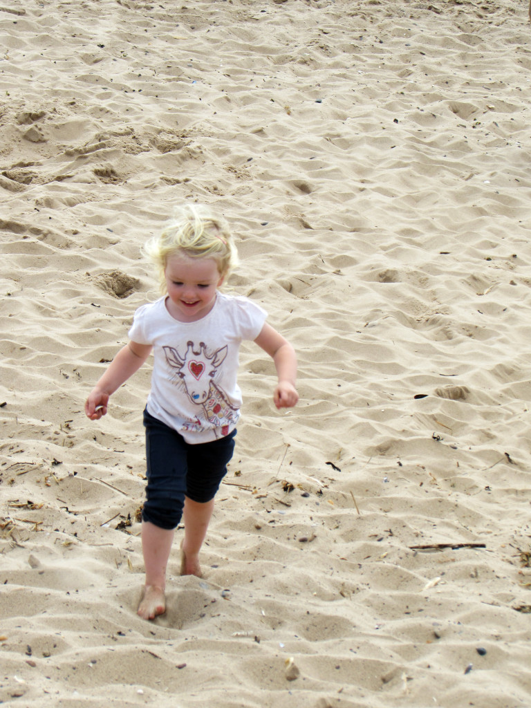 Emily running on the beach