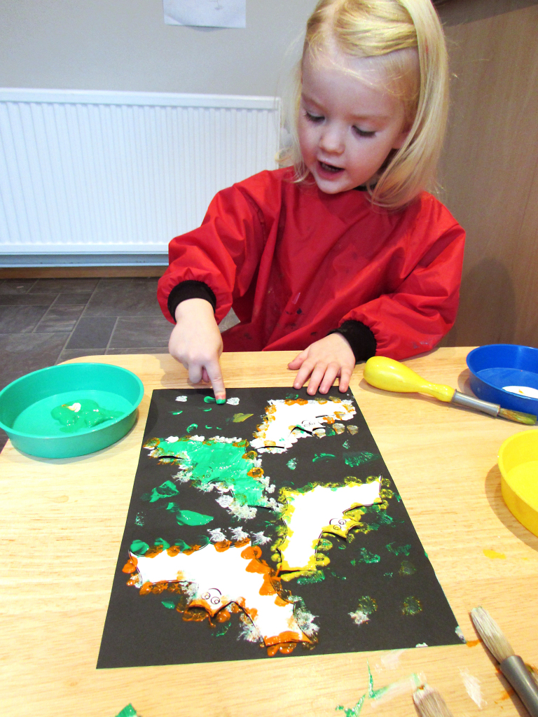 Finger painting halloween bats