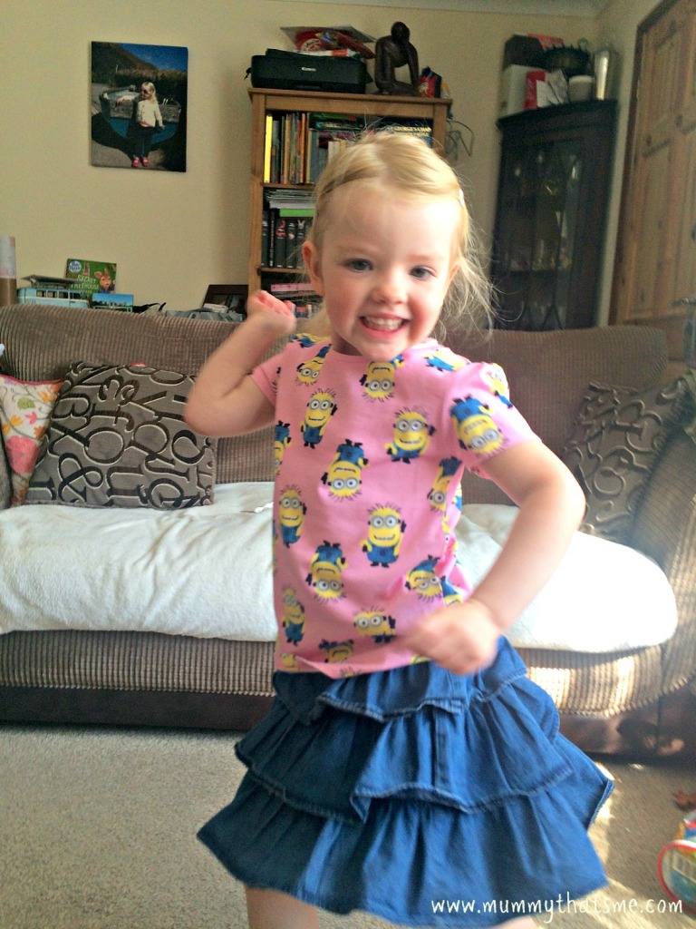 Excited in her minions top