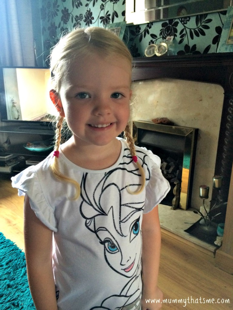 E with her hair in plaits